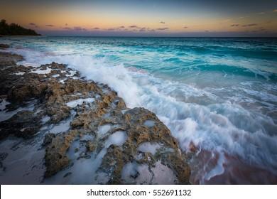 Sea waves splashing at the rocks on the beach in the Bahamas, Eleuthera island