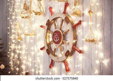 Sea wheel on wall with Christmas lights