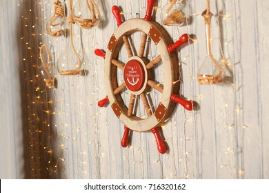 Sea wheel on wall with Christmas decorative lights
