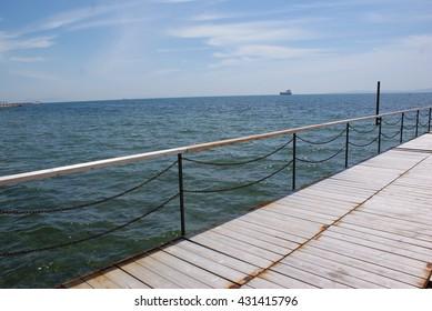 Sea and wood wharf.