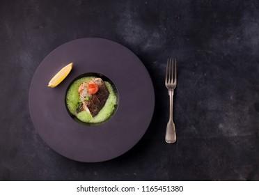 Seabass fillet in molecular spinach filament