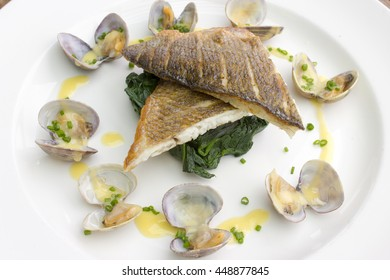 Seabass with spinach, clams & beurre blanc