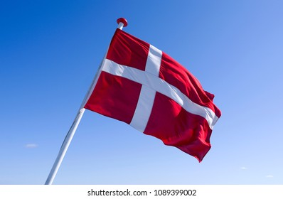 Seafaring / Flags / Denmark: The Danish national flag Dannebrog at the stern of a RoRo vessel is fluttering in the wind