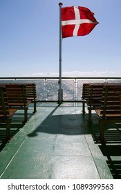 Seafaring / Flags / Denmark: The Danish national flag Dannebrog seen from the sundeck at the stern of a RoRo vessel