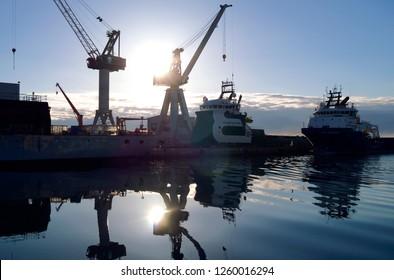 Seafaring / Frederikshavn / Denmark - April 2017: Norwegian platform supply vessels Bourbon Front and Stril Challenger at Orskov shipyard in Frederikshavn at daybreak