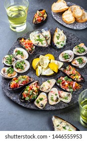 Seafood assorted platter Macha and mussels a la parmesana, mussels a la chalaca, clams with herb sauce.