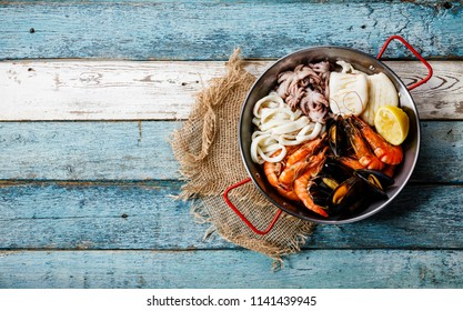 Seafood assorted platter - Prawn Shrimp, Mussels Clams, Squid rings, Octopus mini, Squid on Grill copy space