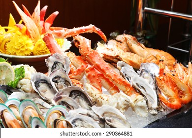 Seafood buffet line (Oyster and Alaska King Crab) in hotel restaurant