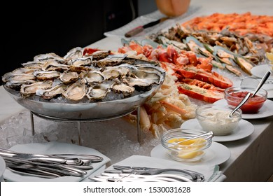 Seafood buffet with oysters, crab, prawns, lobster, razor clam, sauces and lemon served on ice
