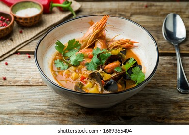 Seafood casserole bowl on wooden table