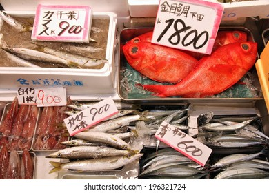 Seafood choice at famous Tsukiji Fish Market in Tokyo, Japan. Barracuda (kinmedai), splendid alfonsino, swordtip squid (shiroika), sayori (needlefish) and swordtip squid.
