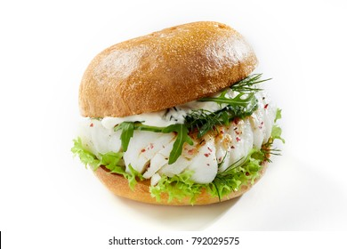 seafood cod fish with salad and mayonnaise isolated against white background
