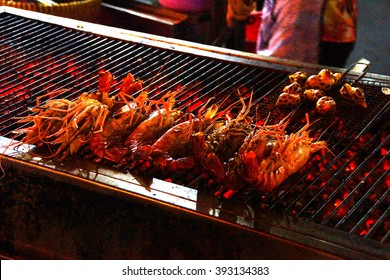 Seafood cooking on flame grill at the night market in Saigon (Ho Chi Minh City),  Vietnam