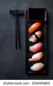 Seafood delicatessen nigiri sushi on plate. Different gourmet snacks. Luxury lifestyle, expensive food, restaurant menu