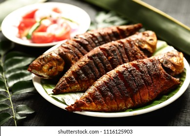 Seafood diet - homemade roasted fish with exotic spices.