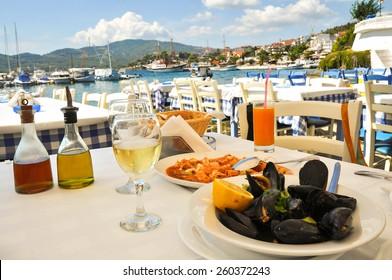 Seafood dinner in a Greece restaurant, Mediterranean sea resort