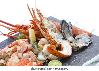 Seafood dish of lobster, prawns, squid, mussels and Alaska King Crab
