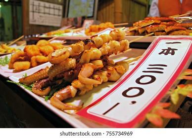 Seafood and fish skewers at Nishiki market, Kyoto, Japan