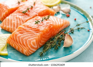 Seafood. Fresh raw salmon or trout fillets with ingredients