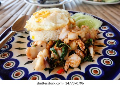 Seafood fried with garlic, chili and holy basil served with steamed rice and fired egg. Thai food