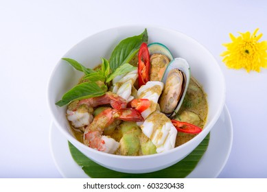 Seafood green curry on white dish , thai food , white background