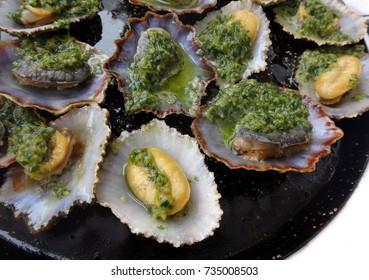Seafood - grilled limpets.Lapas grelhadas