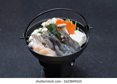 Seafood kaminabe Japanese cuisine isolated