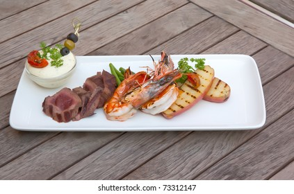 seafood and meat in one plate