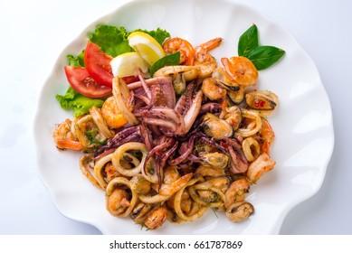 Seafood mix dish , Mussels, Shrimps, octopus, calamari, lemon,salad