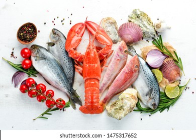 Seafood on a white background. Lobster, fish, shellfish. Top view. Free copy space.