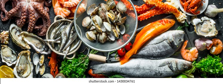 Seafood. Oysters, fresh fish, shrimp, crab with aromatic herbs Top view