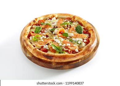 Seafood Pizza with Salmon, Pickled Artichokes, Arugula, Cherry Tomatoes, Mozzarella Cheese and Pesto Sauce Isolated on White Background. Traditional Italian Whole Flatbread on Wooden Plate Close Up