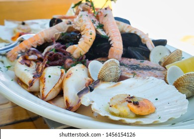 A seafood plate of delicious Adriatic catch of the day  - lobster, prawns, shrimps, oysters, mussels, shells, octopus and calamari in wine buzara sauce