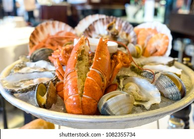 A seafood plate of delicious mediterranean catch of the day served in a famous restaurant of Barcelona - lobster, prawns, shrimps, oysters, mussels, shells, octopus and snails as a spanish dish