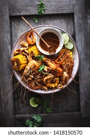 Seafood Plater with Prawn, Squid, Corn and Cajun Spices Sauce. Thai style Seafoods Spicy Cajun