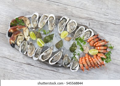 Seafood platter on old wooden board