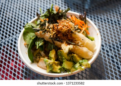 Seafood poke bowl and vegetables