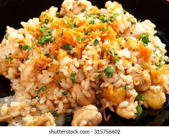 Seafood risotto - rice with shrimps and herbs. Close up.