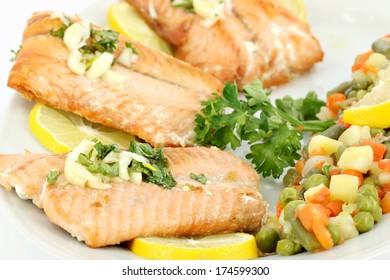 seafood salmon with lemon and vegetables