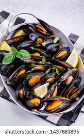 Seafood shell mussels with lemon and basil. Mussels clams in the shells.