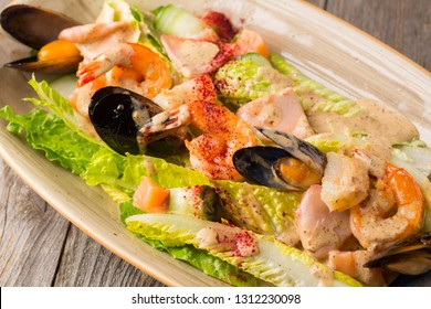 Seafood. Shrimp, mussels and salmon on a plate with salad
