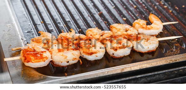Seafood shrimp prawn threaded on wooden skewers. Shrimps is kind of seafood mostly used all over the world, special Mediterranean region, Europe, Thai, China and Australia region, USA, Canada.