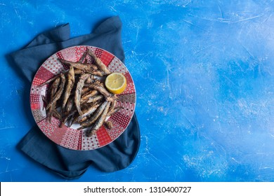 Seafood. Small sea fish, anchovies, sardines. Deep fried food nice to be eaten with beer