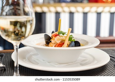 seafood soup and white wine