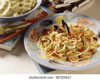 Seafood Spaghetti with cookbooks.