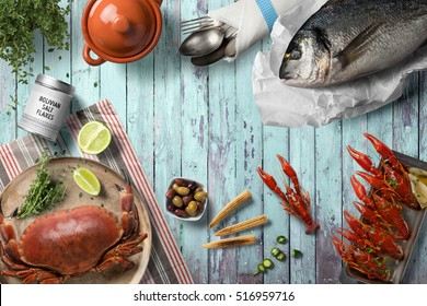Seafood table mix, with fish, cancers, crab on wooden background, top view with, copy space. Rustic food cooking.