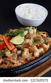 Seafood Teppanyaki, shrimp, scallop, squid, octapus and soy beans served with sauce.