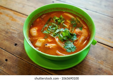 Seafood tomyam soup on wooden table