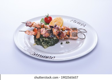seafood with vegetables on a white plate