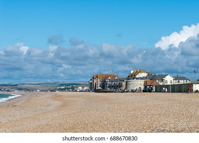 Seaford's promenade is a mix of beach huts and Martello tower